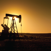 Pumpjack at sunset in northern Montana