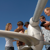 Engineering students and faculty working on wind turbine. MSU photo by Kelly Gorham.