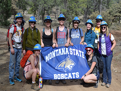 students in front of msu bobcat flag at breaksaway site