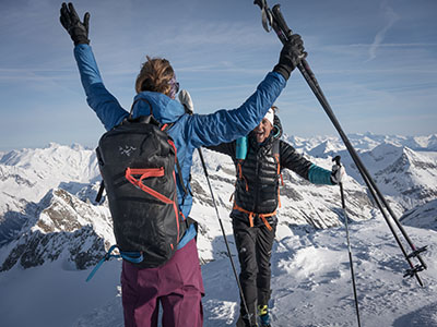 two skiers on top of a mountain
