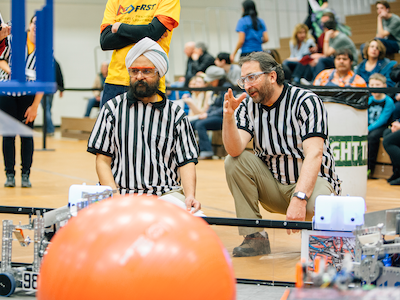 two men judging FIRST Tech Challenge event