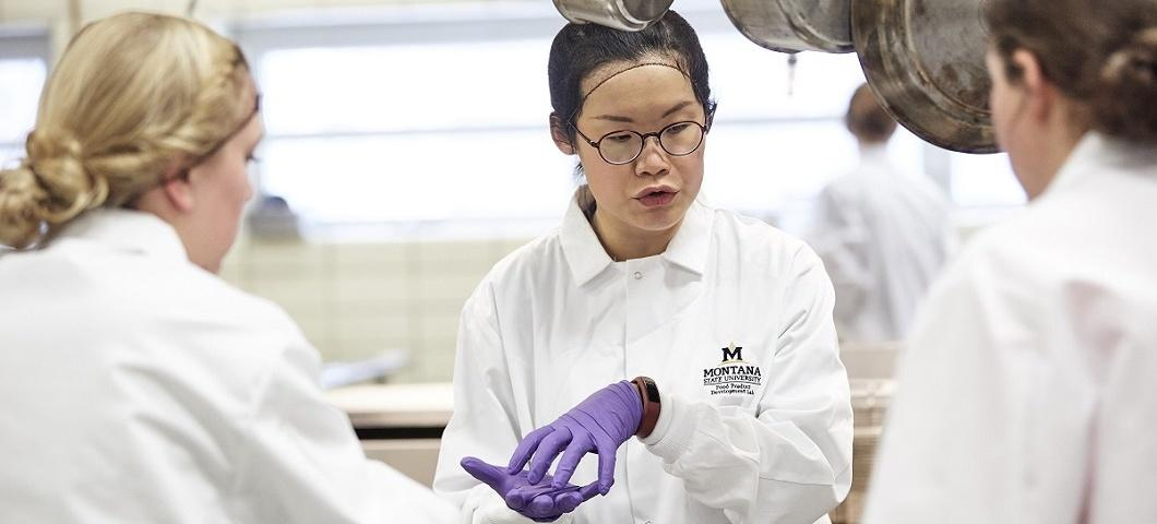 Dr Kuo, the founder of the Food Product Development Lab, explains a food preparation process to student researchers.