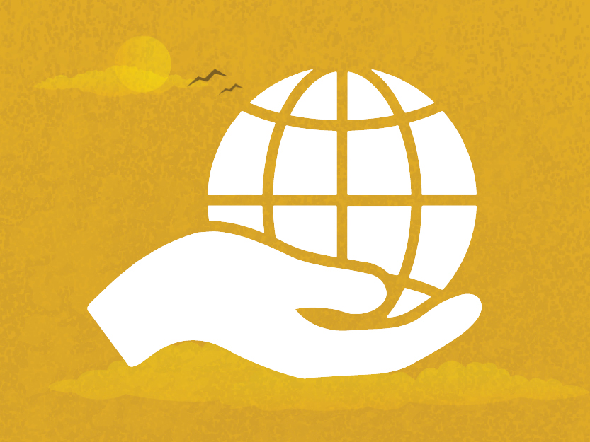 Image of a hand palming a globe on a golden sky background.