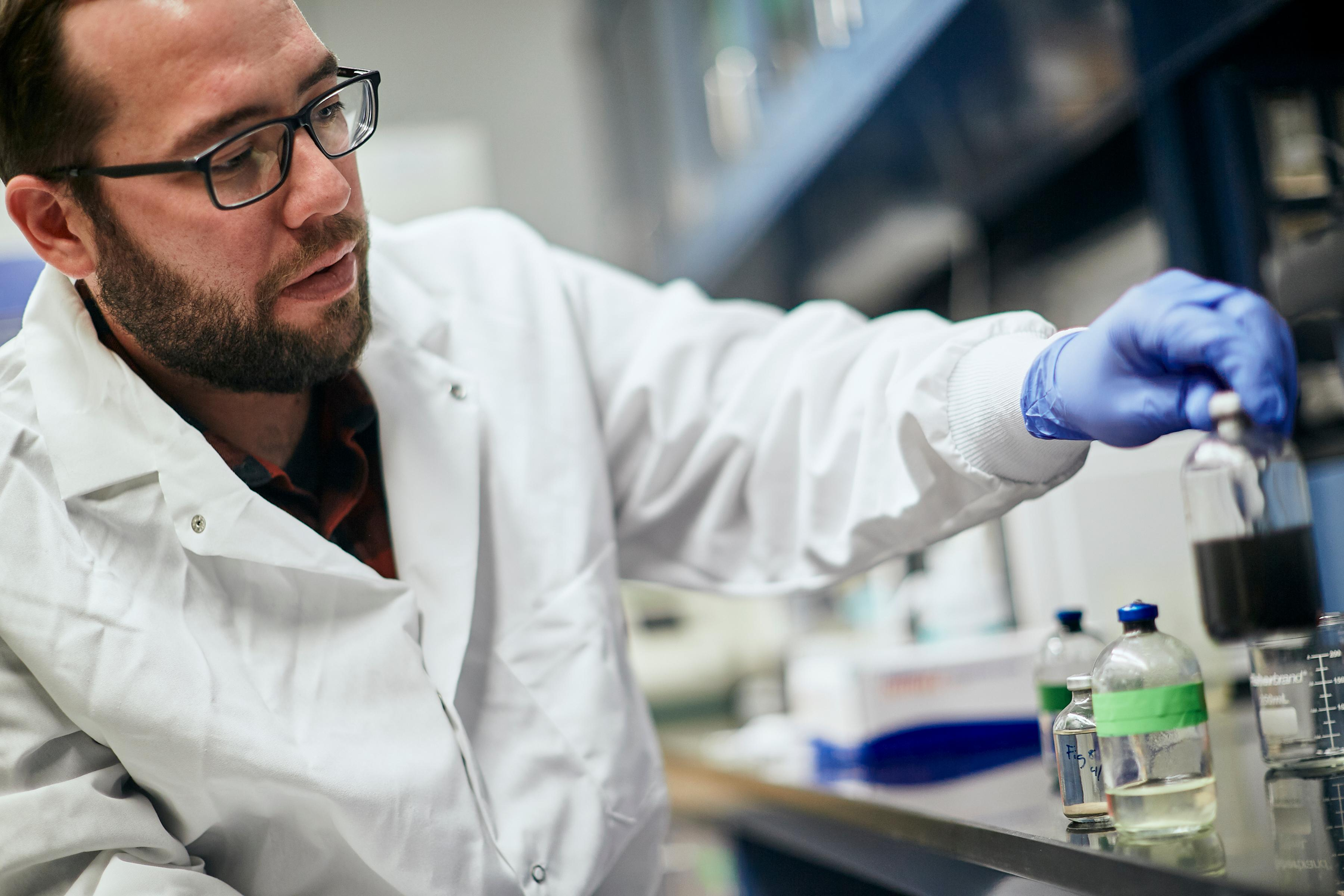 Male researcher working with chemicals in a lab