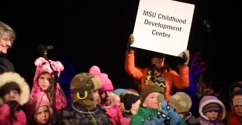 CDC kids participate in lighting of Montana Hall