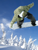 Snowboarder in air grabbing the tail of the snowboard
