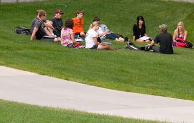 students meeting on the lawn