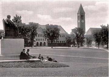 colorless photo of students sitting on a college campus lawn in 1919