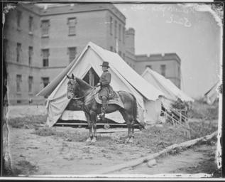 colorless photo of General Joseph Hooker atop a horse during the Civil War