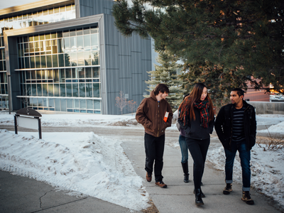 Four international students walking in front of Jabs Hall.