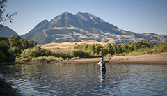 A man fishes in a Montana lake