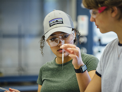 Chemistry student examines a pipette