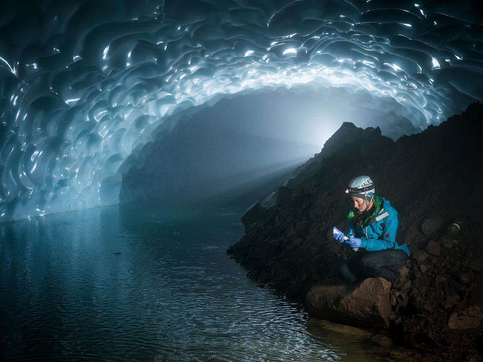 Zoe Harrold inside a large ice cave