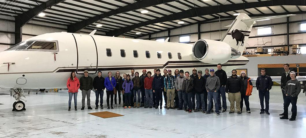 Mechanical engineers in an airplane facility