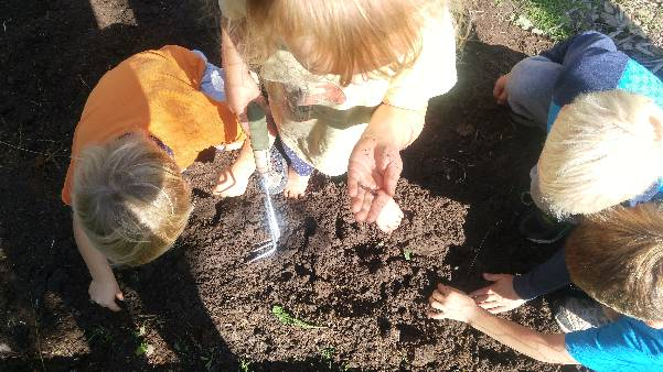 children in garden soil