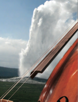 Cello with a geyser erupting in the background