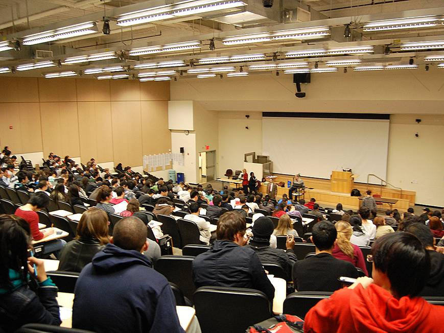 Large lecture hall filled with students