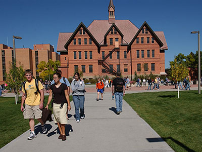 Students walking near Montana Hall on campus