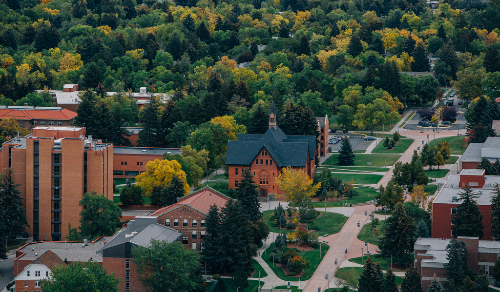 Aerial view of Montana Hall with autumn colors