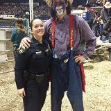 police posing with rodeo cowboy