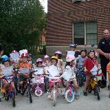 msu police with kids on bikes