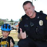 police posing with child