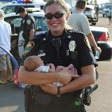 police officer holding baby