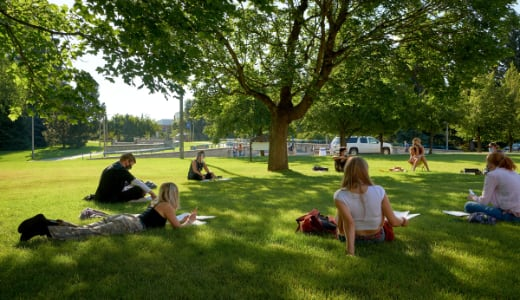 A college class meets on the grass in a socially distanced circle at Montana State University.