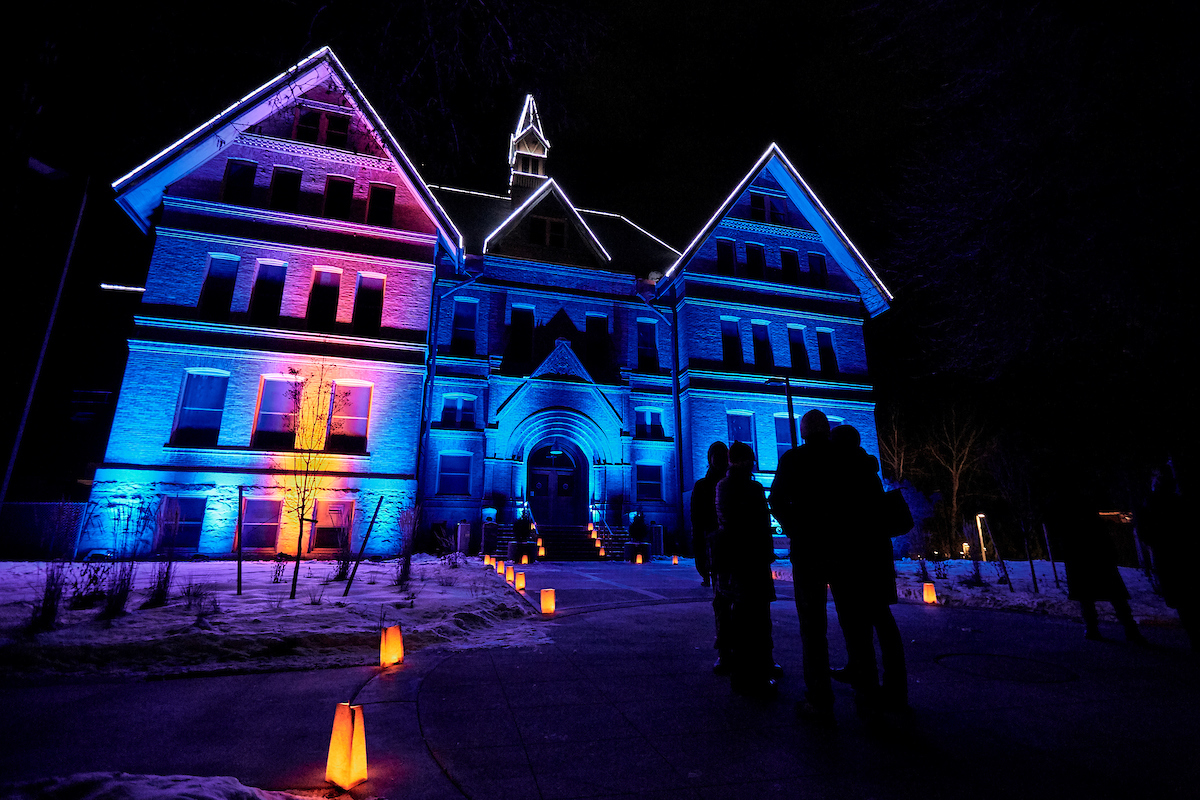 Montana State University's Montana Hall is seen lit with colorful lights for the holiday season.