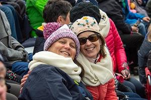 Alison Harmon and Suzanne Held watching the football game
