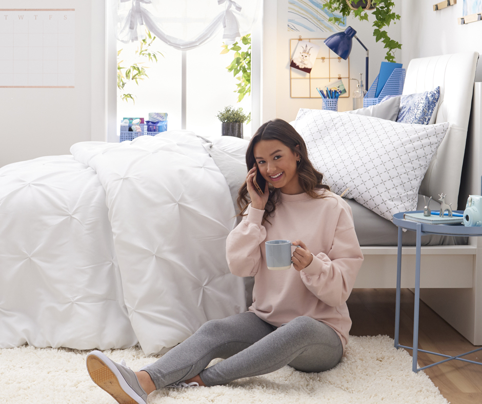Girl on phone against bed