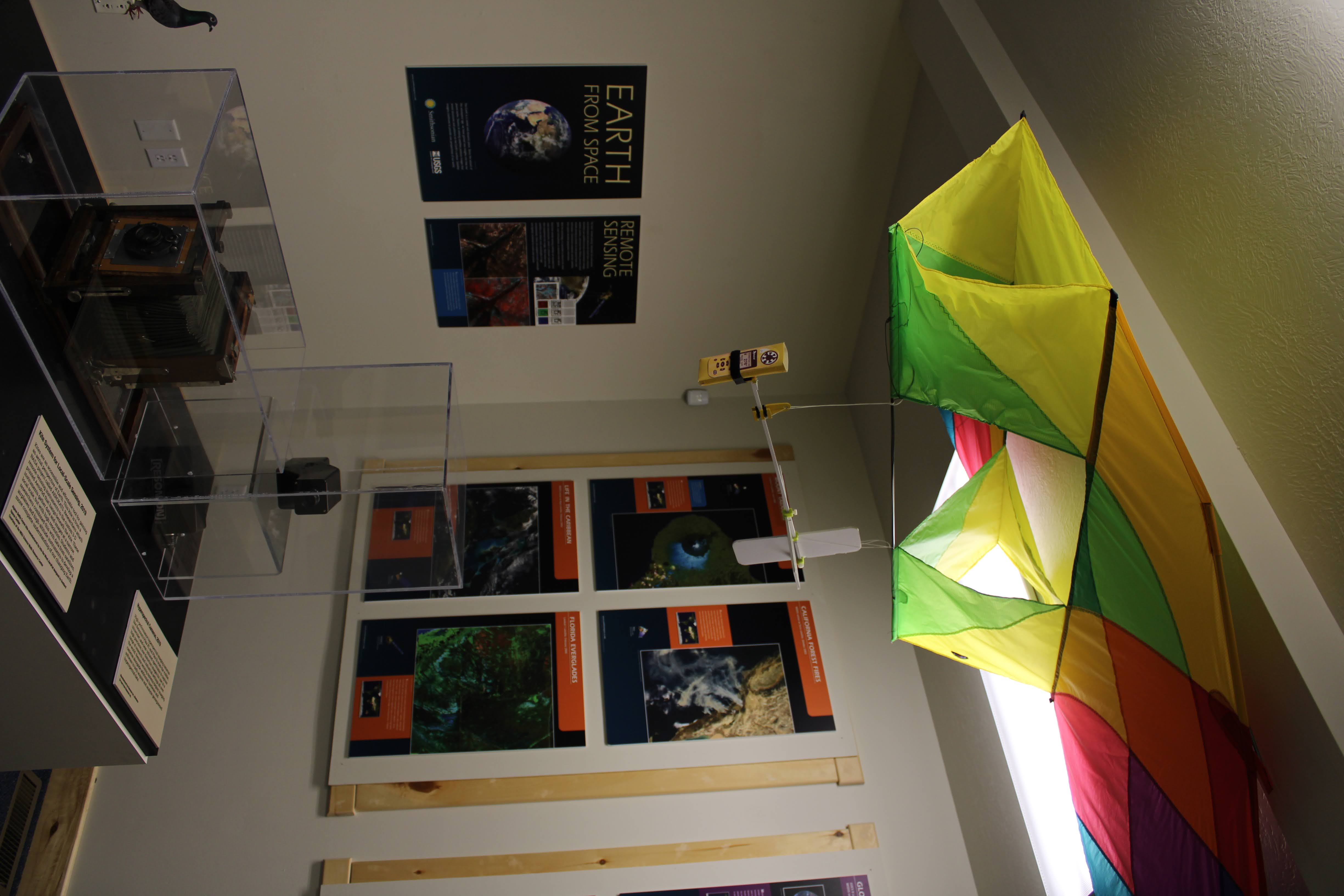 A kite hangs over the remote sensing exhibit