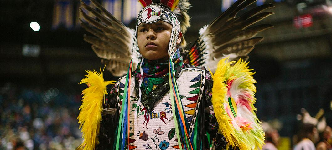 A Native American man in traditional dance regalia