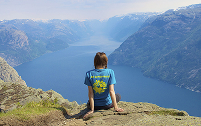 Student looks out over fjord