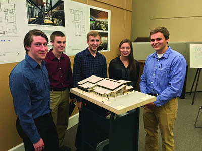 Architecture students holding library model