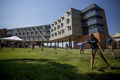 Students playing frisbee outside Yellowstone Residence Hall