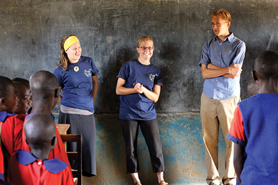 Engineers without borders students work with children in Kenya