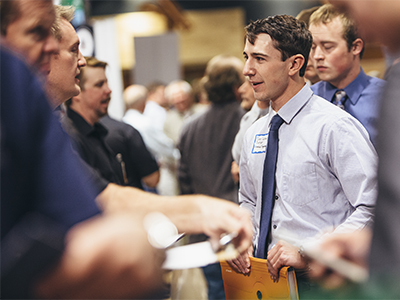 Student speaking to a recruiter at a career fair