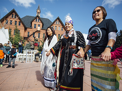 Students celebrate in traditional regalia on Indigenous Peoples Day