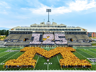 Photo of students forming the M on the MSU football field