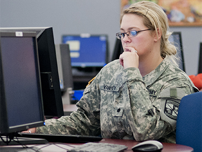 Student veteran working at a computer