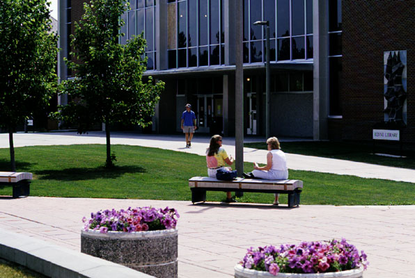 Students sit in front of the library at Montana State University in Bozeman