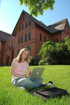 Student studying in front of Montana Hall
