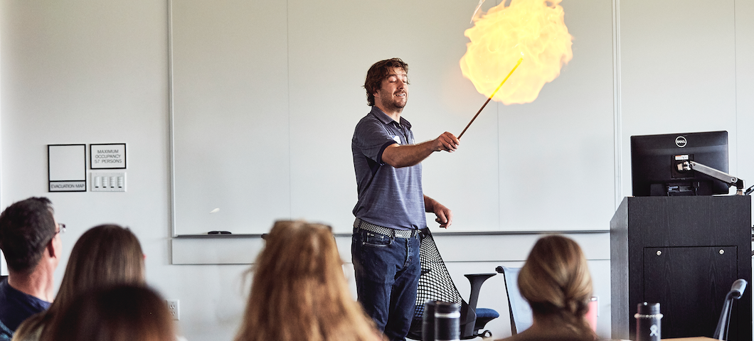 ball of flame as man ignites small balloon of flamable substance in exciting demonstration for k-12 teachers