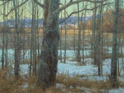 A Clyde Aspevig painting of trees in late winter with snowcapped mountains in the background.