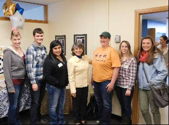 Six students standing with President Waded Cruzado in the TRiO Offices