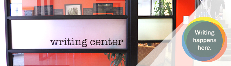 "A window that says, ""The Writing Center"" and ""Writing Happens Here."""