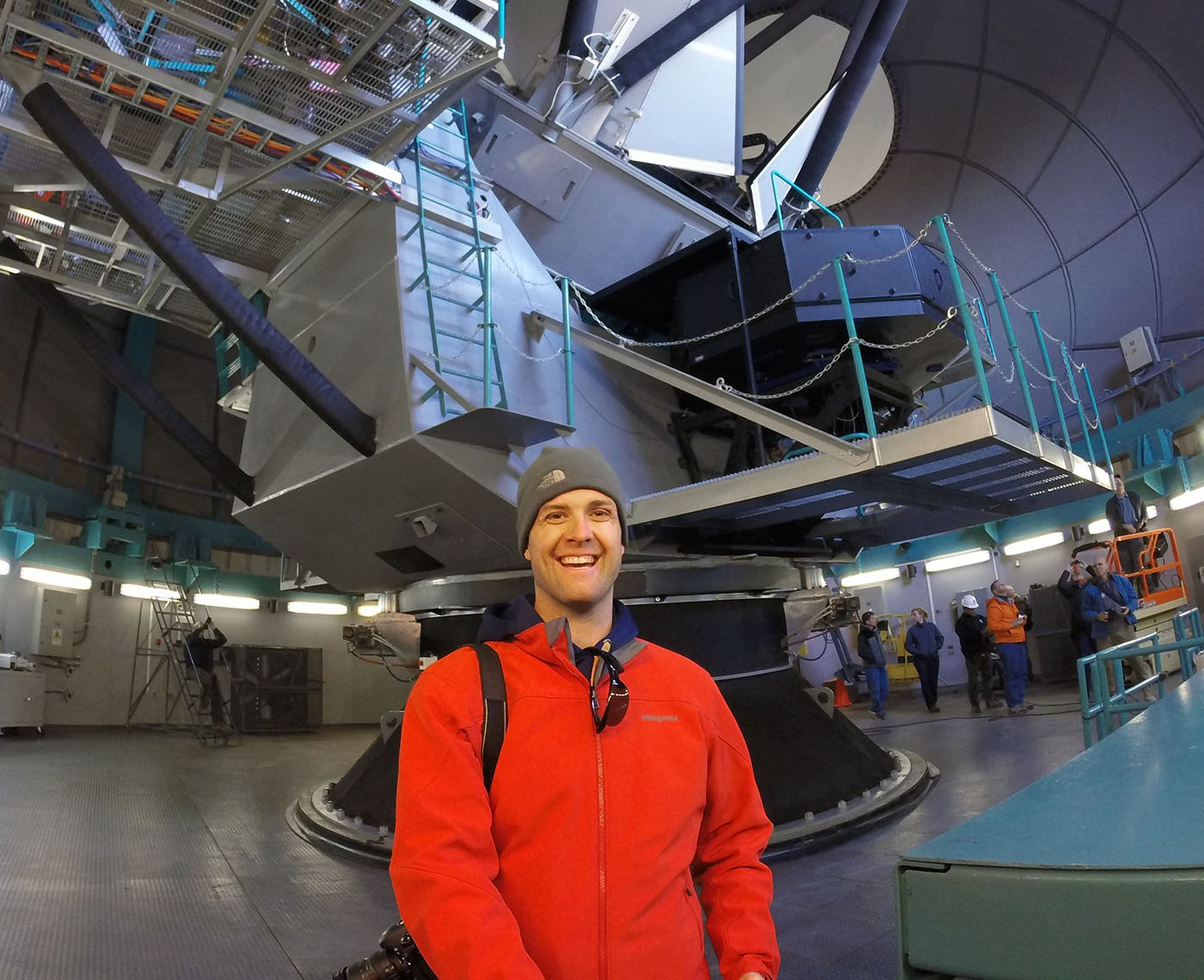 Photo of MSU alum standing near a telescope at Cerro Pachon in Chile.