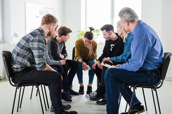 Group counseling session with participats sitting in a circle