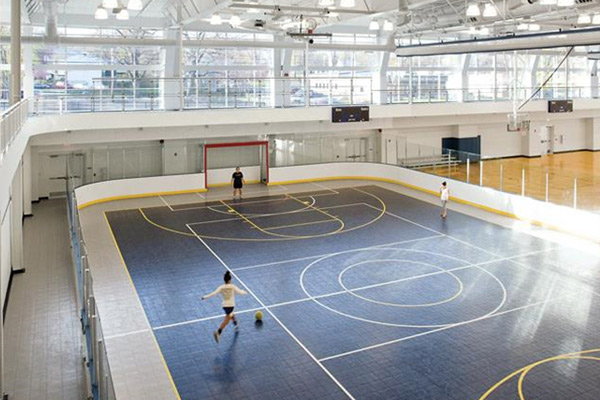 An indoor court featuring users playing soccer